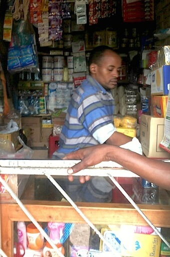 Mr Mungai at his shop in Ruaka, a working class neighbourhood in Nairobi.