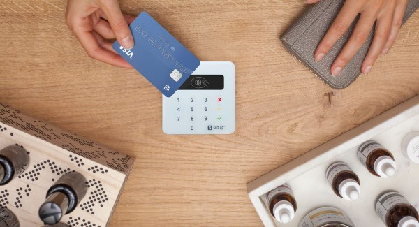 Sumup review affordable no fuss way to take card payments sumup air reader taking a contactless card payment on a desk reheart Choice Image