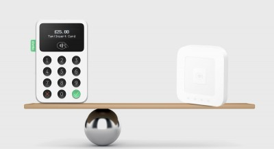 Square Reader and iZettle Reader 2 on a balancing scale